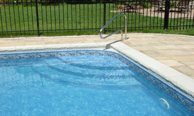 Corner of a swimming pool with stairs