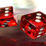a pair of red dice with white pips