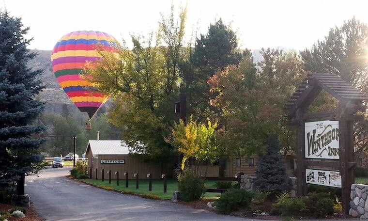 Winthrop Inn entrance multi-colored hot air ballon seen rising in the distance